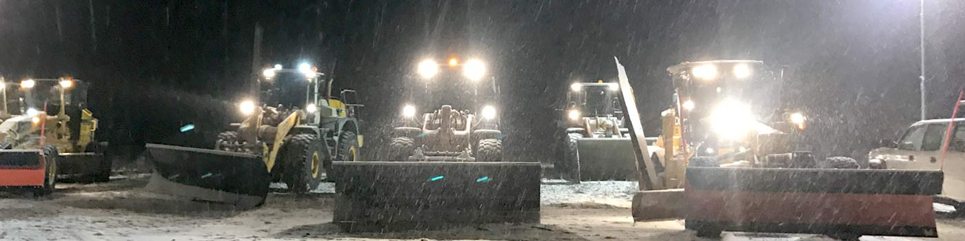 Front loaders ready for deployment during snowstorm at M&F